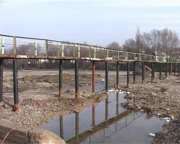 На его строительство этого моста было потрачено 3 млн тенге