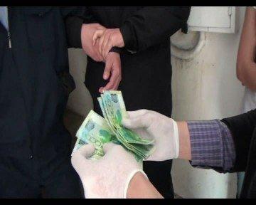 Майор полиции попался на 20 тысяч тенге