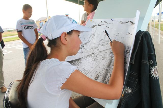 В своей праздничной картине, Земфира Курбанова представляет будущую Астану