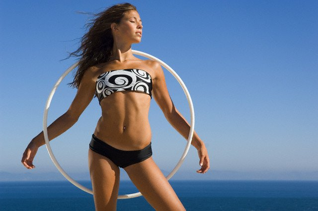 Young Woman with Hula Hoop --- Image by © Ben Welsh/zefa/Corbis