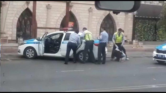На избитую полицейским девушку завели дело по двум статьям