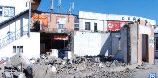 Полуразрушенные здания неподалеку от Бекжана